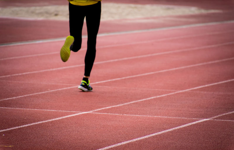 Low section of person running on track