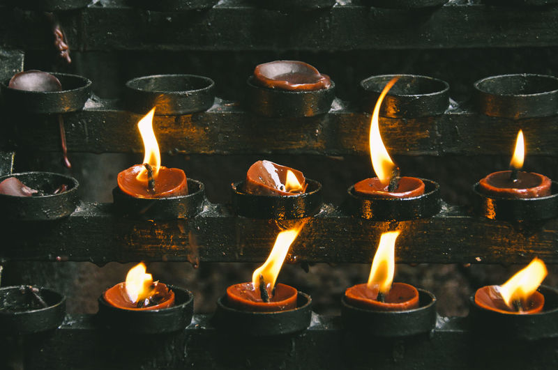Full Frame Shot Of Burning Candles In Temple