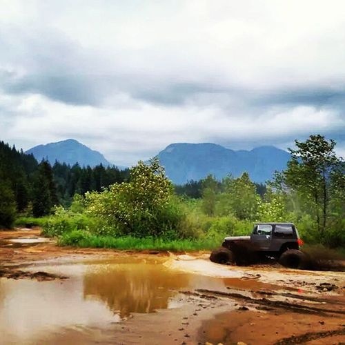 A Jeep at Stave Lake I fell in love with! Jeep Bcjeepclub Stavelake Mudding mudflats mud mudbogging getdirtyorgohome mountains clouds landscape puddles offroad 4x4 4wheel lake thisisthelife lovejeeps trees sand
