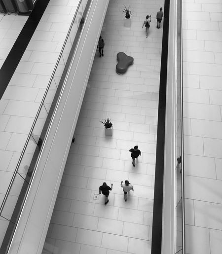 High angle view of people walking on floor in shopping mall