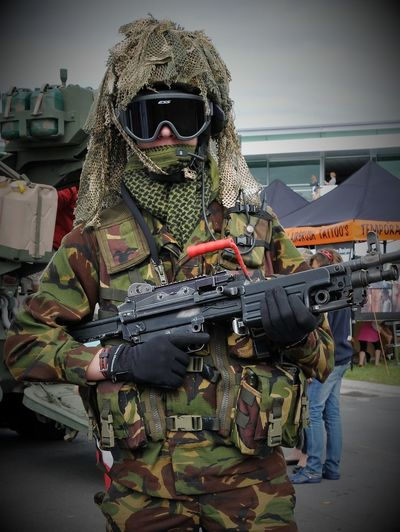 shot of New Zealand army special forces displaying their weapons Shot Of New Zealand Army Special Forces Displaying Their Weapons Zealand, New, Army, Force, Military, Person, Defence, Nz, Weapon, Gun, Soldier, People, Day, Open, Men, Outside, War, Regular, Soldiers, Man, Outdoors, Coast, Island, Security, Vehicle, Arms, Guard, Rifle, Armament, Machine, Parade, Special Force, Command