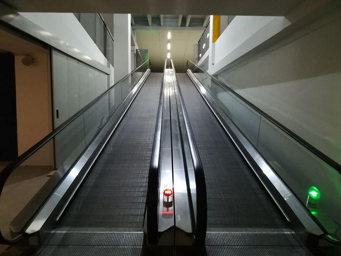 Empty Escalators Underground Parking Stai In Movement Railing Modern Indoors  Architecture Escalator Staircase Illuminated Steps Futuristic Technology Subway Station The Way Forward