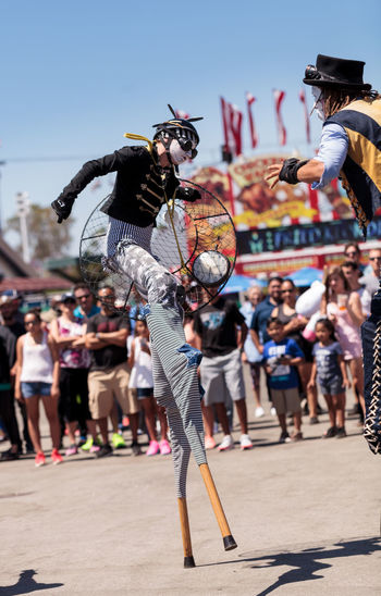 Costa Mesa, CA, USA - July 16, 2016: Dragon Knights steampunk stilt walkers perform at the Orange County Fair in Costa Mesa, CA on July 16, 2016. Editorial use only. Adult Adults Only Crowd Dance Dancing Day Dragon Knights Entertainer Fair Fairground Large Group Of People Match - Sport OC Fair Orange County Fair Outdoors People Perform Real People Stilts Stiltwalker Young Adult