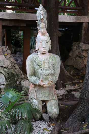 Maya Art Architecture Art And Craft Belief Built Structure Craft Creativity Day Focus On Foreground Human Representation Idol Male Likeness Maya Art Nature No People Outdoors Place Of Worship Plant Religion Representation Sculpture Solid Spirituality Statue