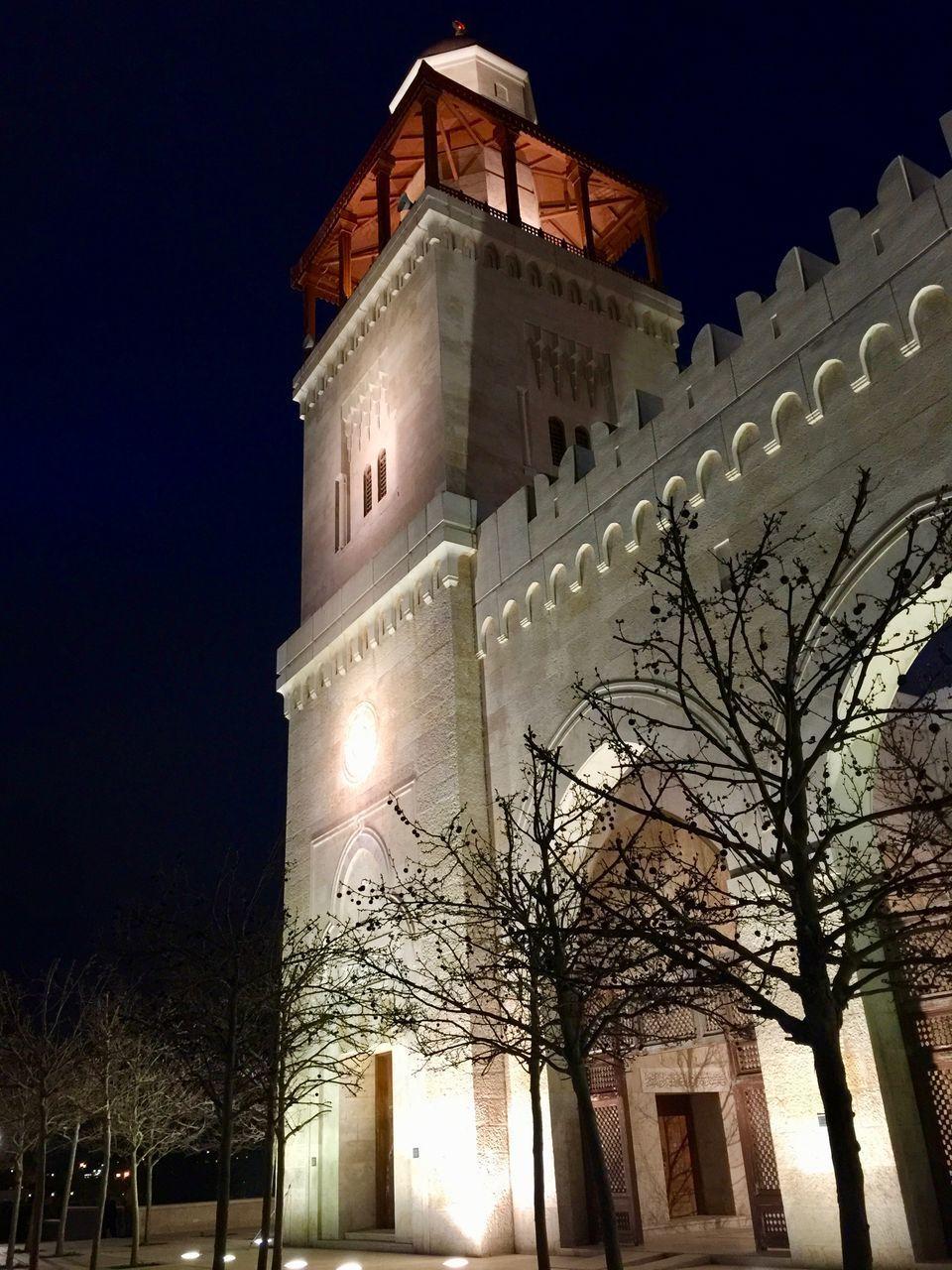 LOW ANGLE VIEW OF ILLUMINATED CHURCH AT NIGHT