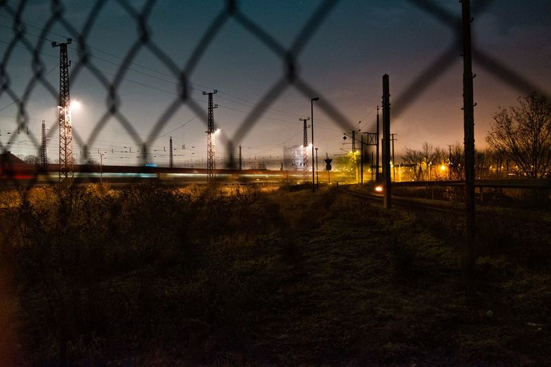 Lights In The Dark Night Sky Fence No People Chainlink Fence Barrier Nature Boundary Metal