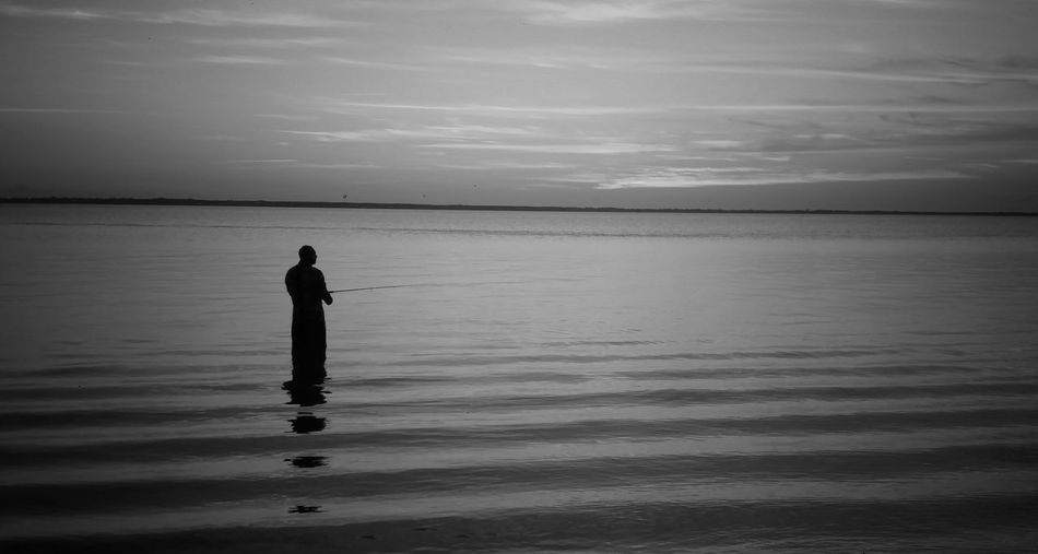 Alone at dawn Nature Photography Artphotography Fishing Time Fishing At Dawn Tranquil Scene Outdoors Early In The Morning Blackandwhite Photography Indianriverlagoon Soft Waves Peaceful Place Peaceful Time