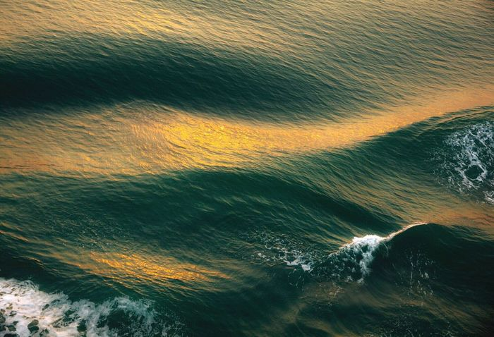 Softly touched by the sun. Waves, Ocean, Nature Waves Motion Beauty In Nature Water Rippled Ocean Surface Level Surfaces And Textures Abstract Abstract Photography Sunlight Evening Light Sea Simplicity Is Beauty. Orange Color Nature's Design OnTheWater Reflection Reflections In The Water My Travels Pacific Ocean
