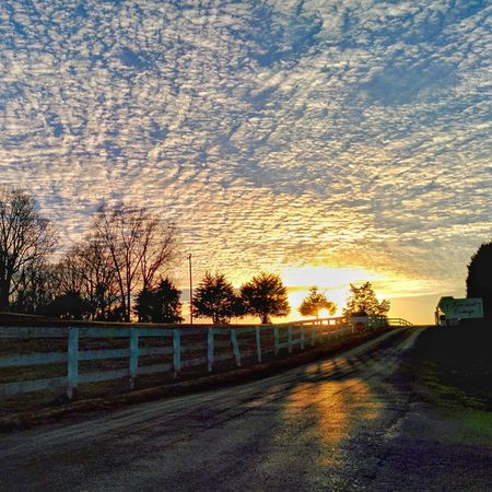 Sunset clouds sky road fence No People Outdoors Beauty In Nature