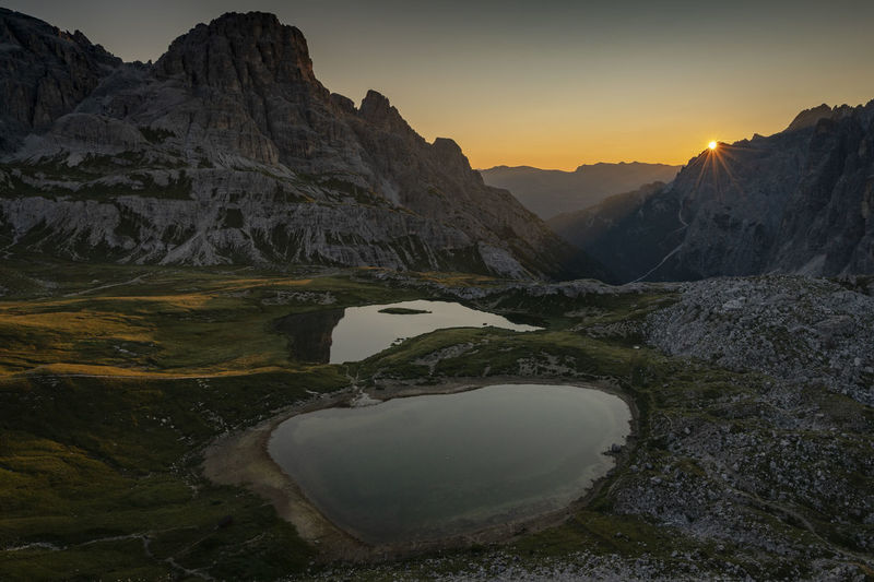 Laghi dei Piani in the sunrise landscape scene near Monte Paterno. Dolomites, Italy EyeEmNewHere Hiking Sun Star Travel Artistic Photography Beauty In Nature Environment Idyllic Italy Laghi Dei Piani Lake Landscape Mountain Nature No People Non-urban Scene Outdoors Rock Scenics - Nature Sky Sun Sunrise Tranquility Water