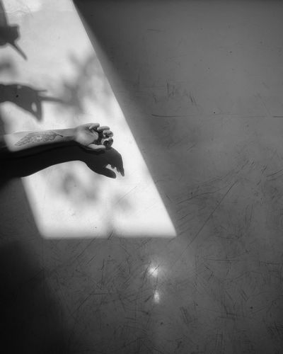 Shadow of woman hand on wall