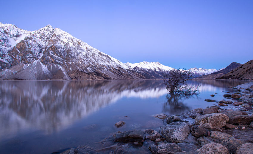 Water Scenics - Nature Beauty In Nature Lake Tranquility Tranquil Scene Cold Temperature Reflection Sky Mountain Winter Nature Snow No People Mountain Range Non-urban Scene Idyllic Day Snowcapped Mountain Outdoors Formation Mountain Peak Dawn Rocks Ranwu Lake Tibet Landscape