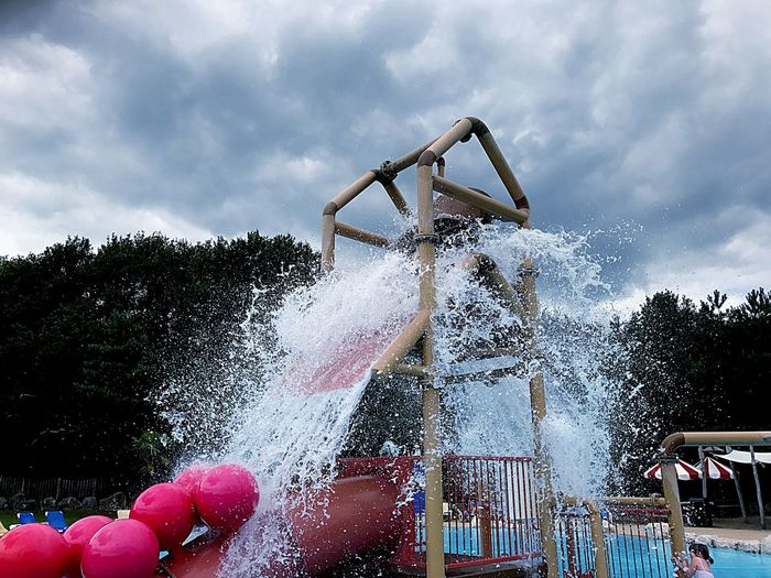 Real People Leisure Activity Tree Cloud - Sky Sky One Person Lifestyles Childhood Motion Day Water Fun Enjoyment Outdoors Spraying Human Body Part Water Slide People