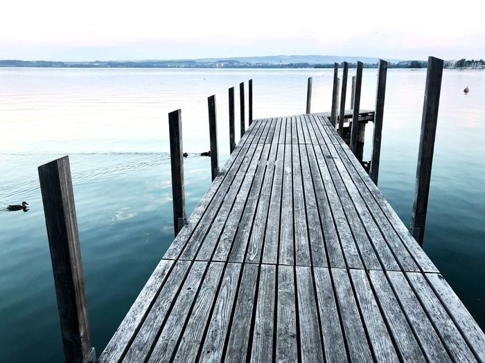 Wooden Pier In Sea Against Sky