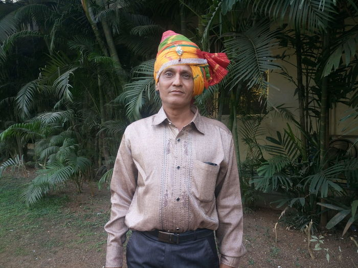 Adult Adults Only Casual Clothing Confidence  Culture Front View Indian Culture  Indian Ethnicity Looking At Camera Looking At Camera Mature Adult Mature Men One Man Only One Person Only Men Outdoors People Portrait Smiling Standing Tradition Traditional Clothing Turban