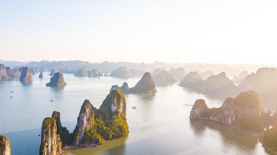 Panoramic shot of rocks in sea against clear sky