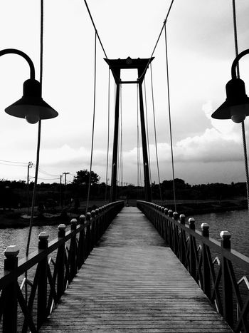 Architecture Bridge Bridge - Man Made Structure Built Structure Connection Day Gas Light Lighting Equipment Nature No People Outdoors Railing Sky Street Light Suspension Bridge The Way Forward Water