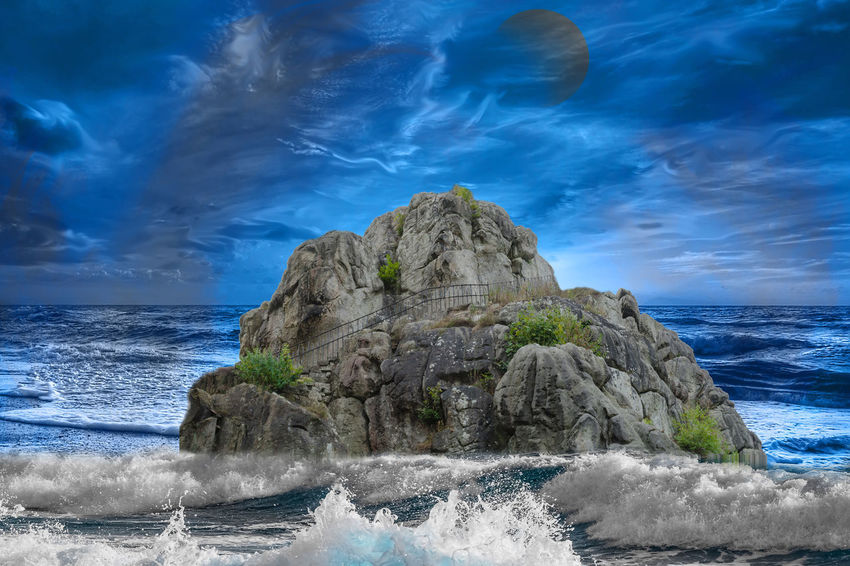 Abstract photomontage the rocks of the Externsteine flooded in stormy sea in front of dramatic sky. Beach Beauty In Nature Cloud - Sky Horizon Horizon Over Water Land Motion Nature No People Power In Nature Rock Rock - Object Rock Formation Scenics - Nature Sea Sky Solid Tranquil Scene Water Wave