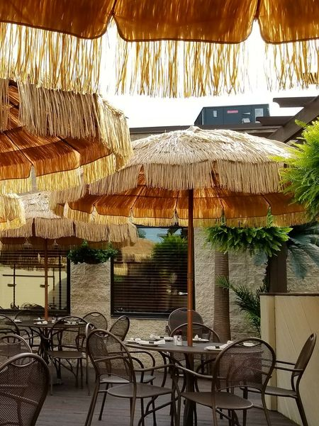 Chair Table Restaurant Day No People Food And Drink Industry Place Setting Architecture Pennsylvania Deck Sunshine Summer Rodney's Restaurant Outdoor Deck Straw Umbrellas Umbrellas Perspectives On Nature The Great Outdoors - 2018 EyeEm Awards