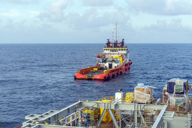 human at sea Offshore Offshore Life Oil Gas Oil As Gas Petroleum Upstream Exploration Drilling Brownfield Anchor Handling Tug Construction Barge Ocean Drilling. Tug Boat Ship Vessel Anchor Handling Tug Boat Diesel Oil Pump Sailing Ship Nautical Vessel Water Sea Sailing Ship Sky Horizon Over Water