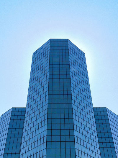 Low Angle View Of Skyscrapers Against Clear Blue Sky