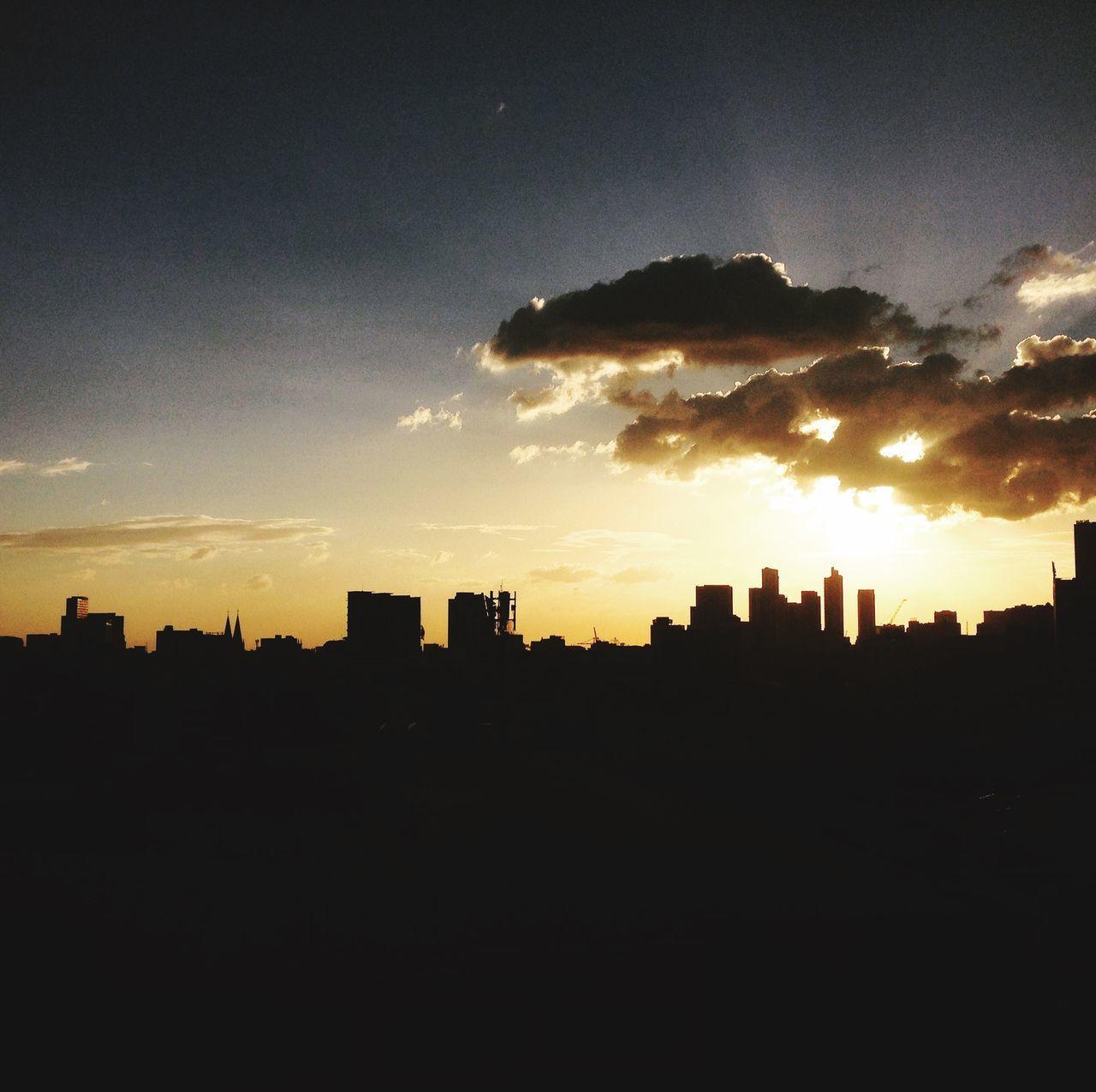 sky, silhouette, cloud - sky, built structure, architecture, building exterior, sunset, no people, nature, city, landscape, building, cityscape, outdoors, urban skyline, orange color, sunlight, beauty in nature, copy space, sun, dark, skyscraper, office building exterior