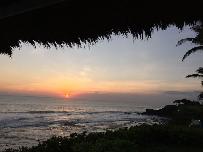 Sunset Tanah Lot Bali Strawroof Frame Palm Trees Waves Gorgeous Colors south sea feeling Horizon Over Water