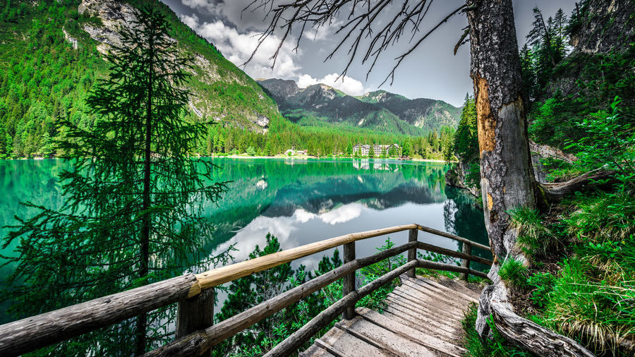 Scenic view of pragser wildsee by trees against mountains