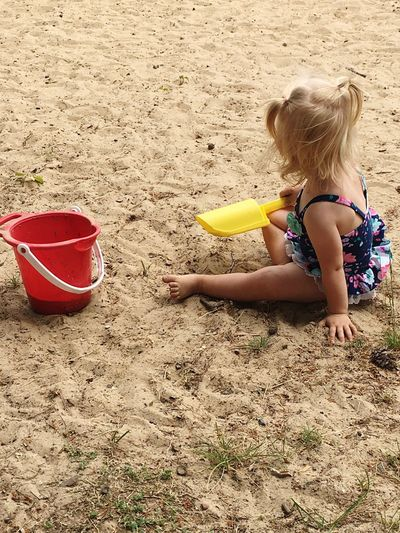 EyeEm Selects Sand Childhood Bucket Sand Pail And Shovel Beach Day Real People Elementary Age Girls Leisure Activity Summer Outdoors One Person Child Lifestyles Michigan Up North Blond Hair People