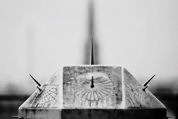 Close-up of clock against built structure