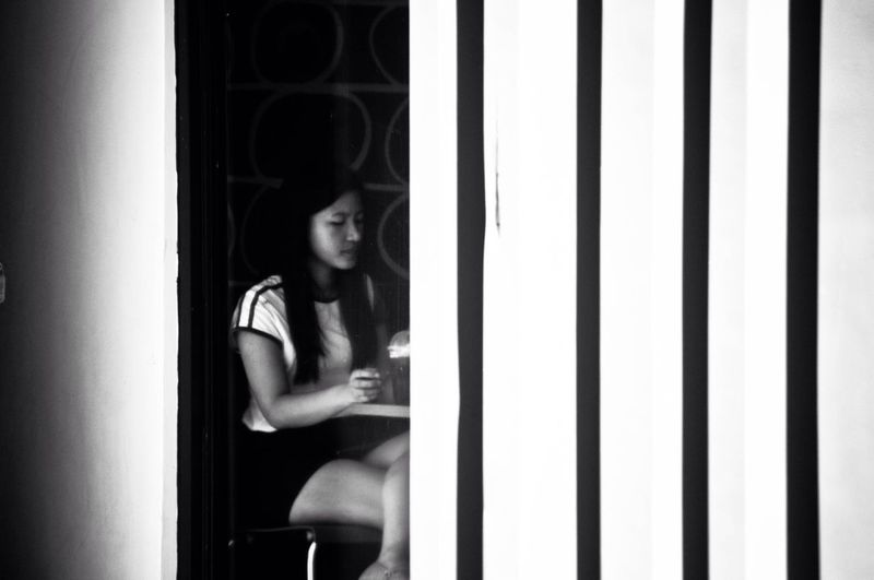 Rethink Things EyeEm Best Shots Young Adult One Person Young Women Three Quarter Length Indoors  Window Beautiful Woman Sitting Real People Bnw_collection Bnw_friday_eyeemchallenge Streetphotography
