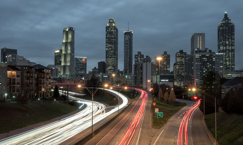 Atlanta cityscape and highway, long exposure shot at dawn Architecture Building Exterior City Cityscape High Street Illuminated Light Trail Long Exposure Motion Night No People Outdoors Road Sky Skyscraper Speed Street Light Traffic Transportation Urban Scene Urban Skyline Mobility In Mega Cities