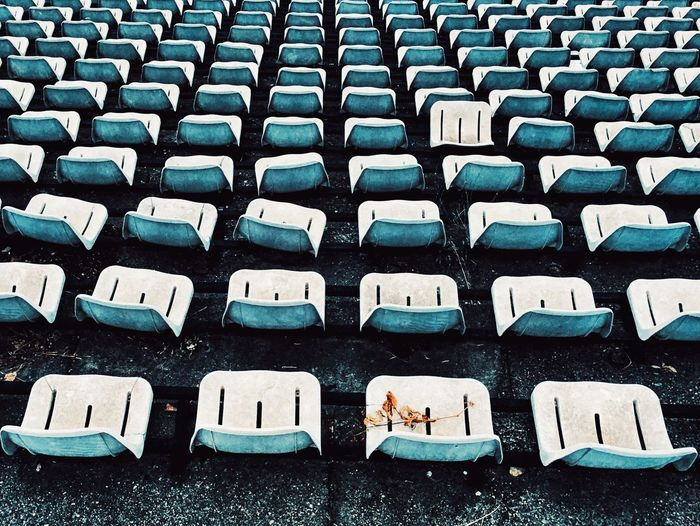 High Angle View Of Empty Chairs In Old Stadium