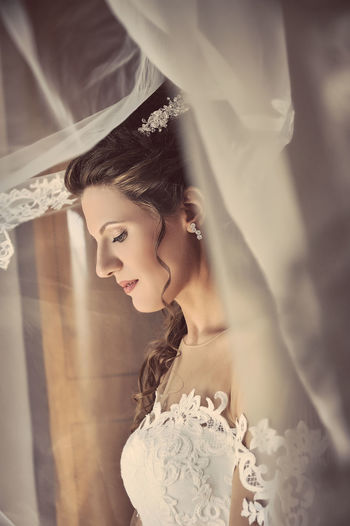 Side View Of Young Bride At Home