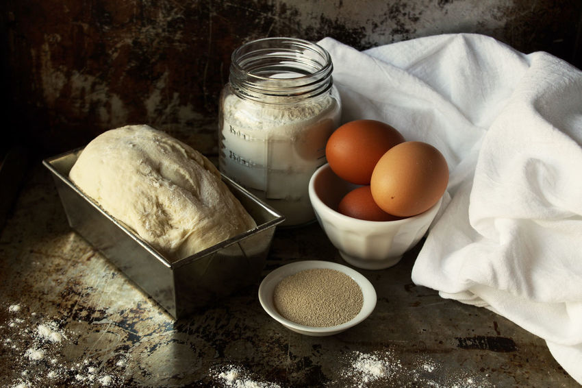 Baking bread Baking Bread Dough Loaf Of Bread Flour Yeast  Messy Ingredients Baked Still Life Studio Shot Indoors  Copy Space Rustic Dark Egg No People Homemade Close Up Focus On Foreground Raw