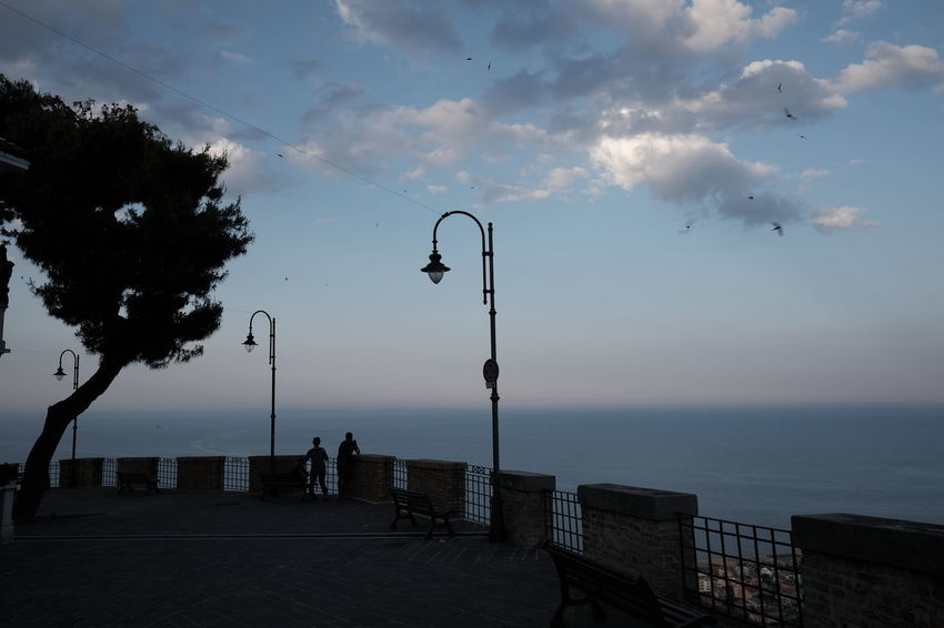 Beauty In Nature Cloud - Sky Day Horizon Over Water Nature No People Outdoors Scenics Sea Silhouette Sky Street Light Tranquil Scene Tranquility Water