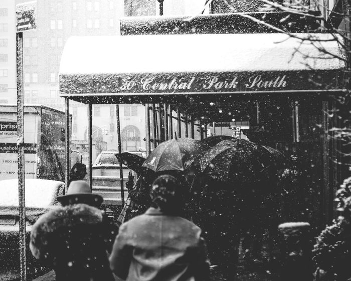 Snow in New York City Real People Built Structure Men Architecture Building Exterior Lifestyles Rear View Snow Photographing Outdoors Day Two People Togetherness Photography Themes Technology City Adult People Only Men Adults Only