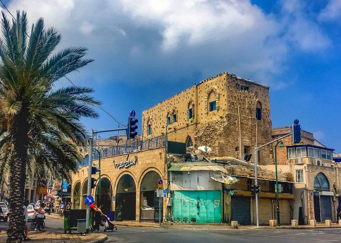 The port city of Jaffa, sporting gorgeous colors to accompany its historical cityscape. Architecture Built Structure Building Exterior Sky Cloud - Sky Tree Real People Travel Destinations Day Outdoors Men Palm Tree Large Group Of People Women Nature People buildings Colorful turquoise Street Jaffa Israel TelAviv Jaffa Port Jaffa palm trees Palm Trees City Cityscape Downtown First Eyeem Photo EyeEmNewHere
