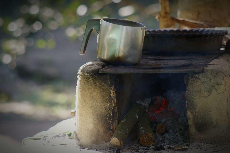 Close-up of mug on metal