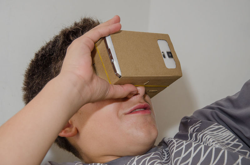 Close-up of boy wearing virtual reality simulator