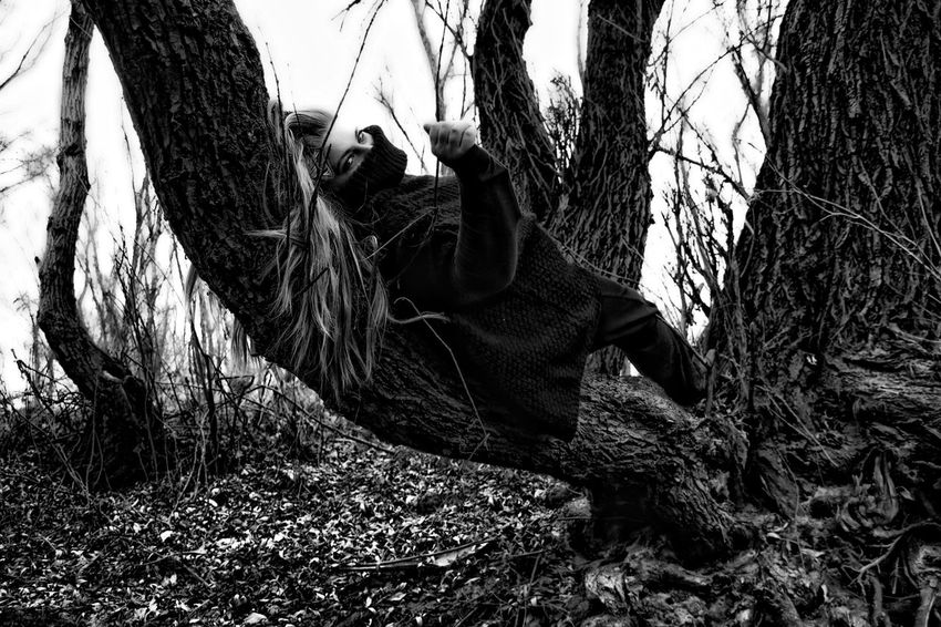 was made one with the trunk of the tree Black And White Fine Art Photography Forest Glamour Moody Mystery One Person Outdoors People Real People Solitude Tree Tree Trunk Waiting Woman Woman In Forest Woods