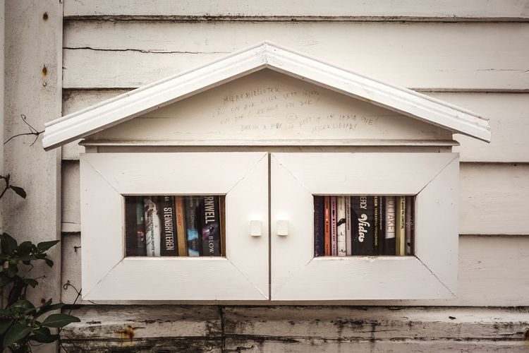 Micro library Books Library Micro Reading Building Cultures Day Education Good Attitude Guest House Idyllic Miniature No People Open Outdoors Reading A Book Sharing  Street Wall Wood - Material