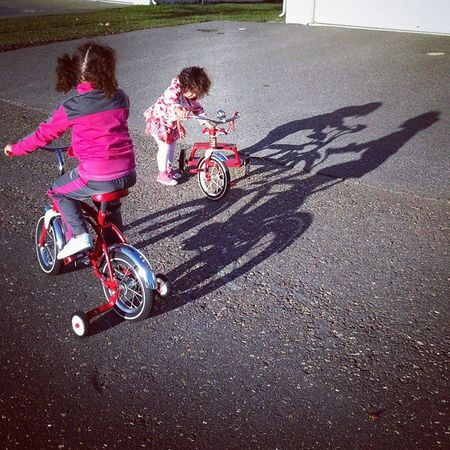 Riding their bikes @radioflyer Unforgettableinstagram Shootyourlife PuddleWonderful Photography redbike