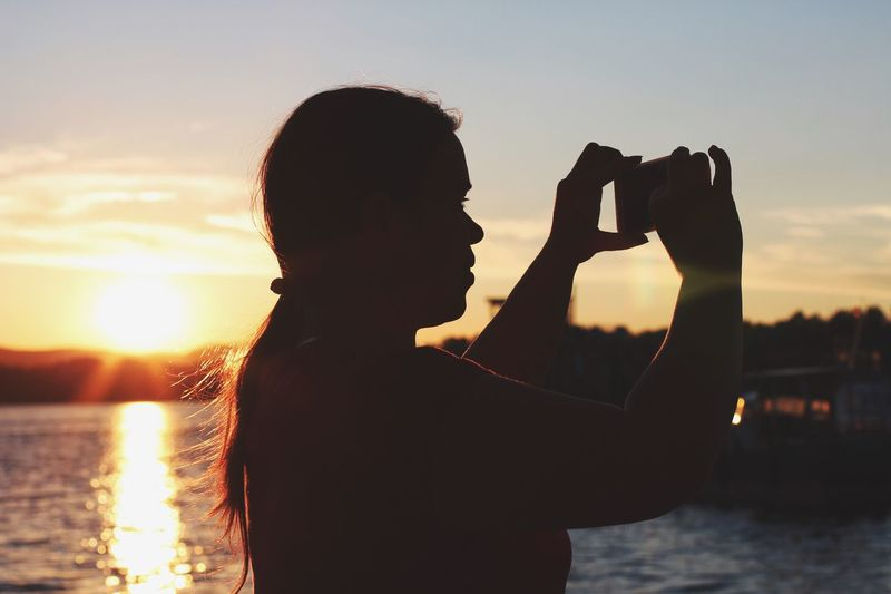 Place Of Heart Sunset Water Real People Photographing Silhouette Sky One Person Photography Themes Camera - Photographic Equipment Outdoors River Sun Technology Sommergefühle Paint The Town Yellow
