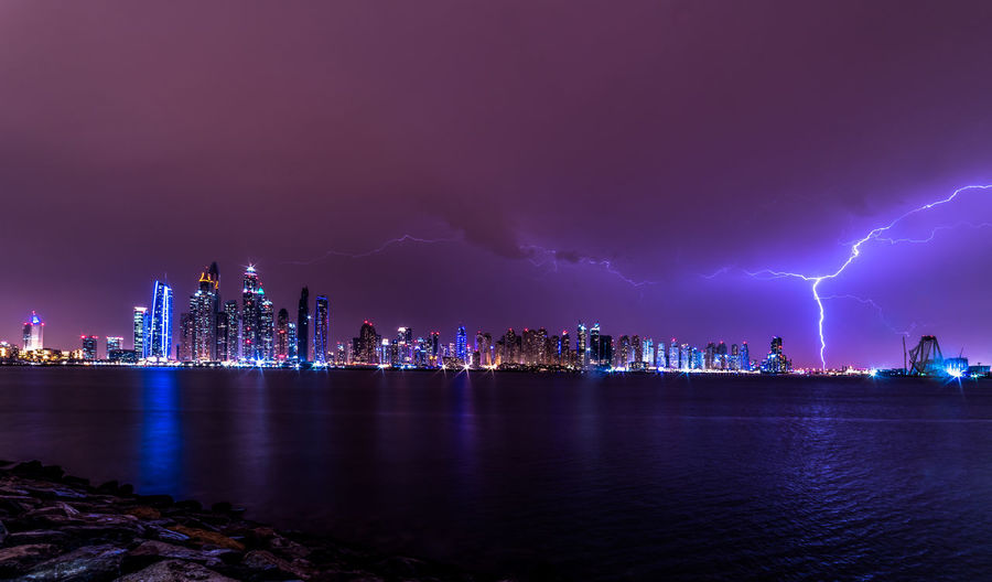 View Of Illuminated Dubai City At Night In Storm