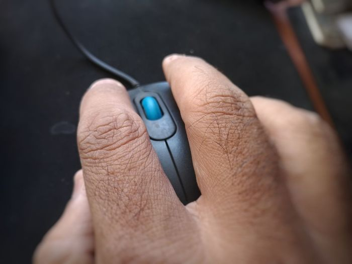 Cropped Hand Using Computer Mouse