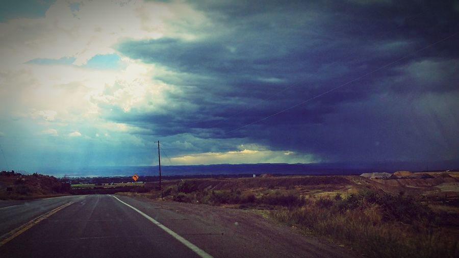 Each Day God gives us a choice on the roads we travel, choice to walk on the light side or choose to travel in the darkness, this is the road we choose whether to walk thru the rainbow or travel thru the rain. The Way Forward Road Landscape Country Road Outdoors Solitude Nature Empty Road Cloud - Sky Day God's Beauty Positive Message Colorado Photography LuV?!photography First Eyeem Photo