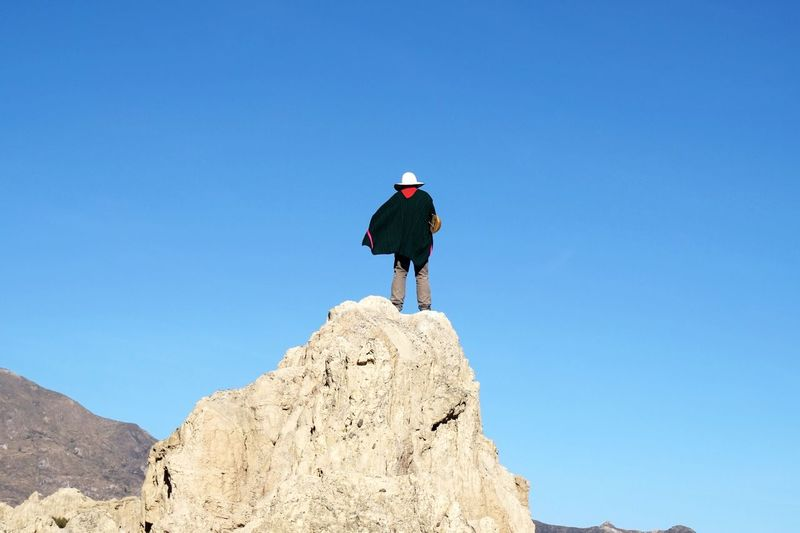 Blue Clear Sky Full Length Adventure Rock - Object Hiking Rear View Day One Person Copy Space Outdoors Low Angle View Backpack Real People Sunlight Standing Leisure Activity Nature Mountain Scenics EyeEmNewHere
