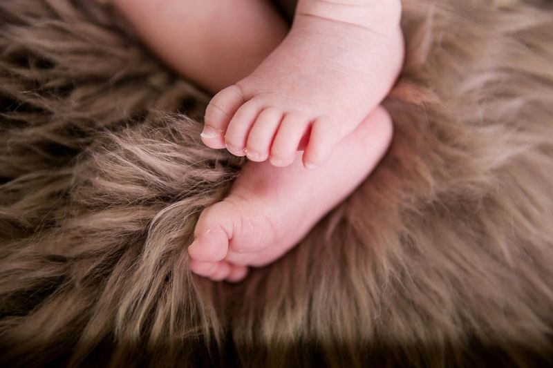 Low Section Of Baby Relaxing On Fake Fur