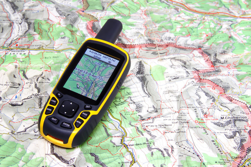 GPS receiver on background map. Backgrounds Close-up Compass, Orientation Composition Detail Drow Excursion Geocaching GPS Gps Globe Map Paper Maps Mountain Orientiring Outood Plan B Programming Techno Technology Trail Travel Traveling Trekking Wireless Technology